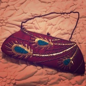 Embroidered clutch by k c malhan.